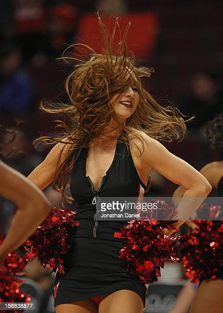 A member of the Chicago Bulls dance team The Luvabulls performs during a game between the Bulls and the Charlotte Bobcats at the United Center on...