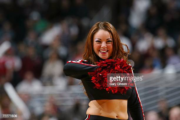 A member of the Chicago Luvabulls dance team performs during a preseason game between the Minnesota Timberwolves and the Chicago Bulls at the United...