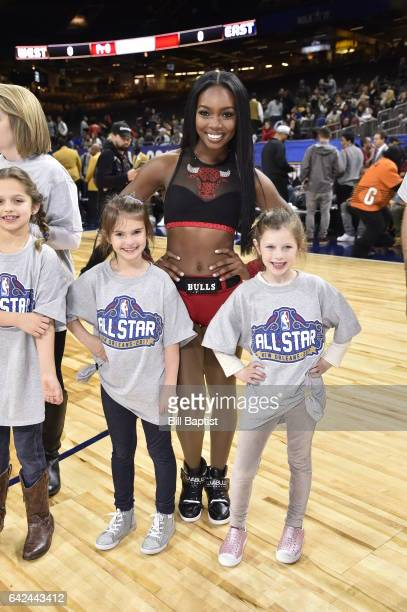 A member of the Chicago Luvabulls poses for a photo with young fans before the NBA AllStar Celebrity Game as a part of 2017 AllStar Weekend at the...
