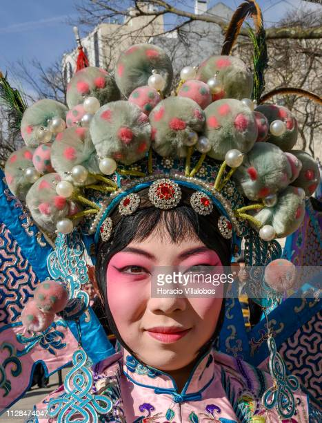 A member of the China National Peking Opera Company participates of the parade in costume staged by locals and Chinese residents in Portugal to...