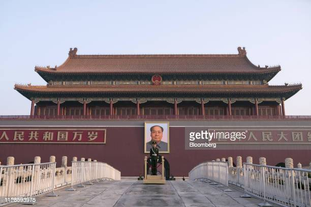 Member of the Chinese People's Armed Police stands guard in front of a portrait of former Chinese leader Mao Zedong at Tiananmen Square in Beijing,...
