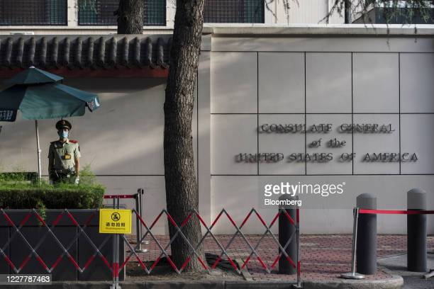 Member of the Chinese People's Armed Police stands in front of the U.S. Consulate General Chengdu in Chengdu, China, on Sunday, July 26, 2020....