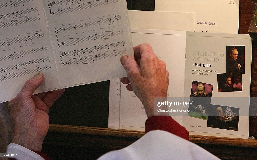 A member of the choir sings during the funeral of snooker star Paul Hunter on October 19, 2006, Leeds, England. The three time masters champion died of stomach cancer last week after a long battle against the disease.