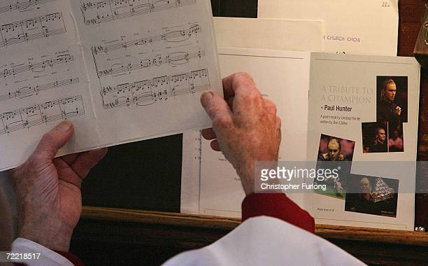 A member of the choir sings during the funeral of snooker star Paul Hunter on October 19 Leeds England The three time masters champion died of...