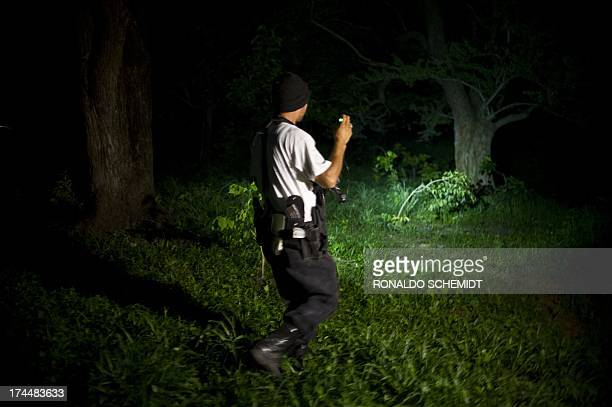 A member of the Citizens' SelfProtection Police takes part in a security operation in Aguililla Michoacan state Mexico on July 25 2013 Citizens...