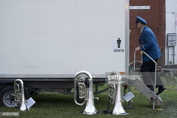 A member of the City of Traralgon Band from Australia uses the lavatory after competing in the Whit Friday brass band competition in the village of...