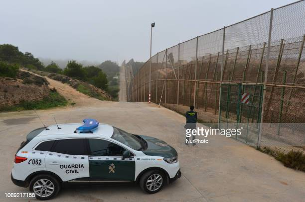 Member of the Civil Guard observing the border fence at the MoroccoSpain border in the city of Melilla, one of two Spanish cities in north of Africa....