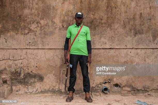 A member of the Civilian Joint Task Force poses at the Bakassi Internally Displaced Peoples Camp on July 6 2017 in Maiduguri The Nigerian Military...