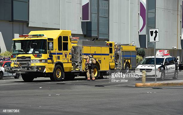 A member of the Clark County Fire Department adjusts his gear outside an entrance to The Cosmopolitan of Las Vegas after a fire broke out on a...