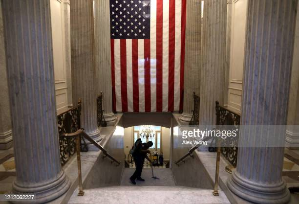 Member of the cleaning crew vacuums stairs at the U.S. Capitol March 12, 2020 on Capitol Hill in Washington, DC. The U.S. Capitol Visitor Center has...