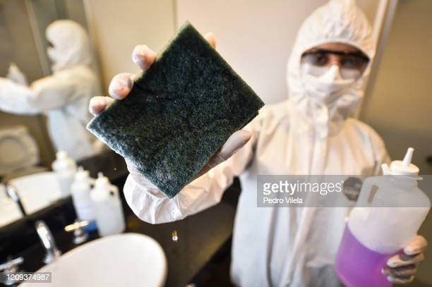 Member of the cleaning team disinfects a room at the Vivenzo hotel, which continues to operate despite the new coronavirus pandemic on April 7, 2020...