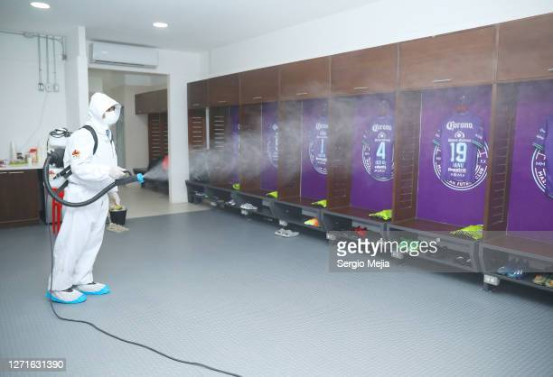 Member of the cleaning team sanitizes as part of the Covid-19 protocolprior the 9th round match between Mazatlan FC and Tijuana as part of the Torneo...