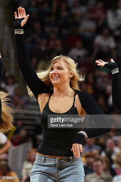 A member of the Cleveland Cavaliers Girls gestures as she tries to keep the fans on their feet during a break in play against the New York Knicks on...