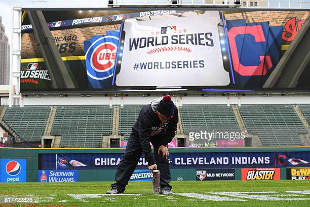 A member of the Cleveland Indians grounds crew paints the World Series logo on the field prior to Media Day at Progressive Field on October 24 2016...