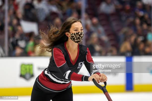 Member of the Cleveland Monsters Ice Patrol scrapes the ice during the third period of the American Hockey League game between the Syracuse Crunch...