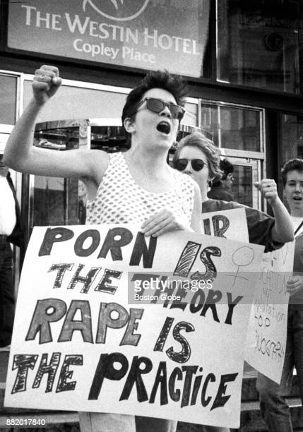 A member of the Coalition of Women Against Playboy Magazine raises her first during a protest in front of the Westin Hotel in Boston where the...