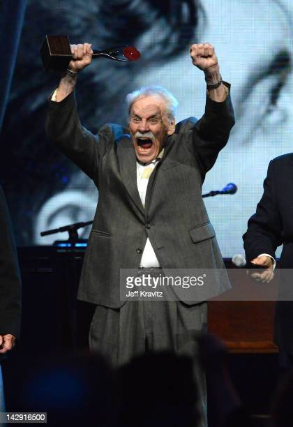 A member of the Comets celebrates on stage at the 27th Annual Rock And Roll Hall Of Fame Induction Ceremony at Public Hall on April 14 2012 in...