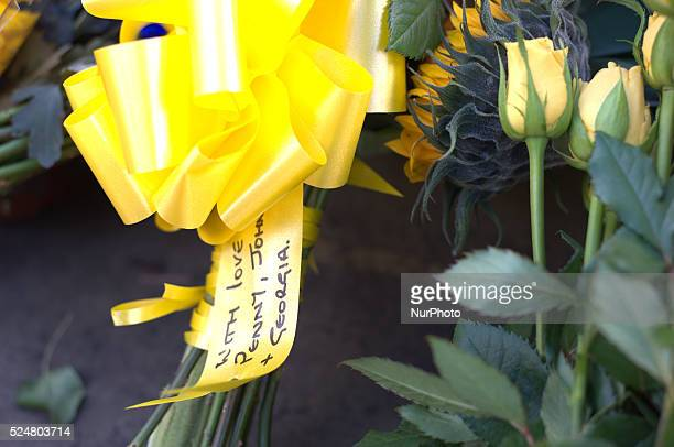 A member of the community laying a floral tribute for Alan Henning in Eccles town centre in Salford England