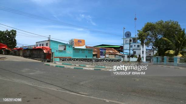 A member of the Comoros armed forces walks by the entrance of the 'Medina' on the island of Anjouan Comoros on October 19 2018 Comoros security...
