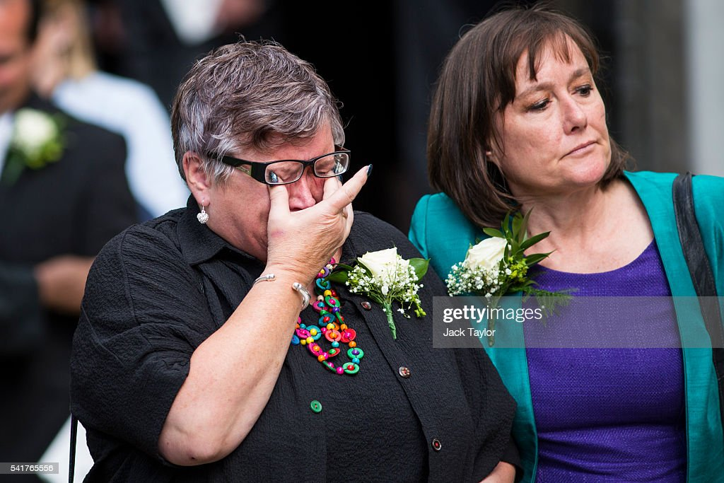 A member of the congregation cries as she leaves St Margaret's church following a remembrance service for Jo Cox on June 20, 2016 in London, England. Parliament was recalled from recess today so MPs could pay tribute to Jo Cox, Labour MP for Batley and Spen, who was murdered in her constituency last Thursday.