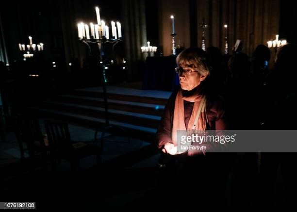 A member of the congregation leaves following the Advent Procession at York Minster on December 02 2018 in York England The candlelit service...