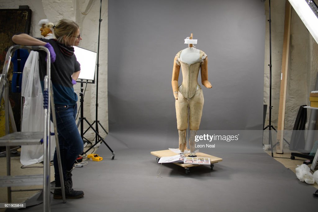 A member of the conservation team looks on during the fitting of a 'pair of straight bodies' to the funeral effigy of Elizabeth I at Westminster Abbey on February 20, 2018 in London, England. The bodice was supplied by the Queen's tailor, William Jones, to Elizabeth's own pattern and was made especially for the effigy which was carried on the hearse at her funeral in 1603. Among the details discovered during conservation work is that the boning finishes slightly lower on the right-hand side, allowing right-handed Elizabeth greater ease of movement. The corset will be among 300 objects from the Abbey collection on display in The Queen's Diamond Jubilee Galleries when they open at Westminster Abbey in June.