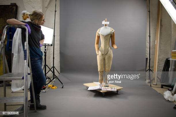 A member of the conservation team looks on during the fitting of a 'pair of straight bodies' to the funeral effigy of Elizabeth I at Westminster...