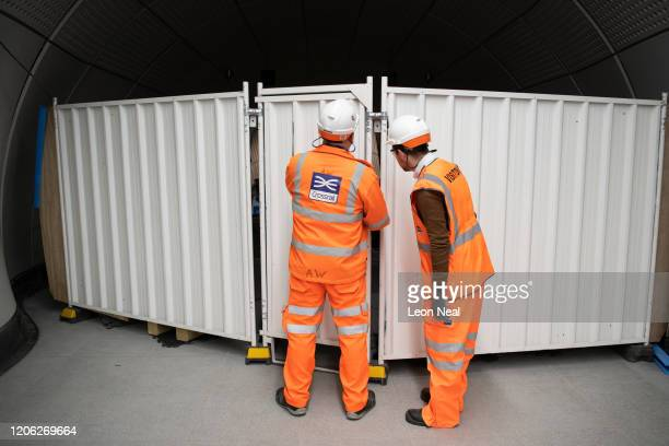 A member of the construction team opens a barrier at the top of the escalator system in Liverpool Street Crossrail station on February 14 2020 in...