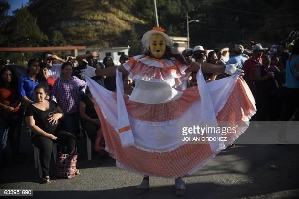 A member of the 'Convite de fieros de San Jose' traditional dance group takes part in the celebrations of the Virgin of Candelaria in Villa Lobos...