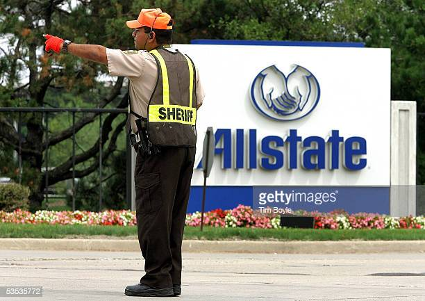 A member of the Cook County Sheriff's Police department directs traffic outside Allstate's corporate campus August 30 2005 in Northbrook Illinois...