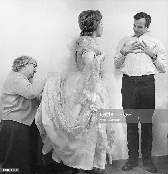 A member of the costume department assists Italian soprano Mirella Freni with her costume for the Mozart opera 'Don Giovanni' at Covent Garden Opera...