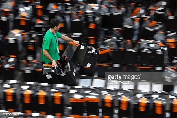 TOPSHOT A member of the count staff carries opened and processed ballot boxes past rows of sealed boxes still awaiting processing at a count centre...