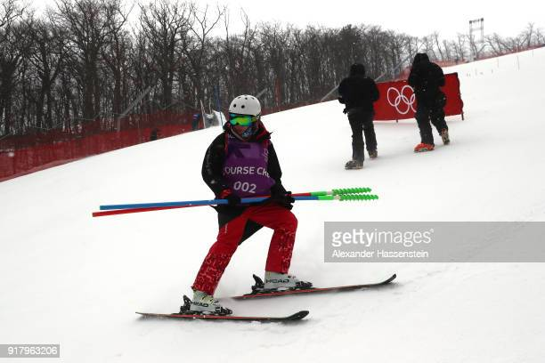 A member of the course crew positions slalom poles prior to the Alpine Skiing Ladies' Slalom on day five of the PyeongChang 2018 Winter Olympics at...