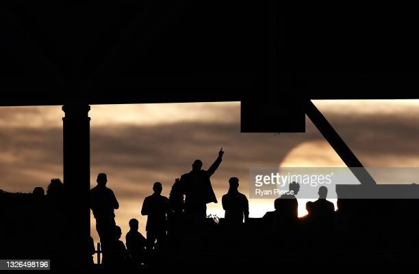 Member of the crowd cheers as the sun sets during the 2nd One Day International match between England and Sri Lanka at The Kia Oval on July 01, 2021...