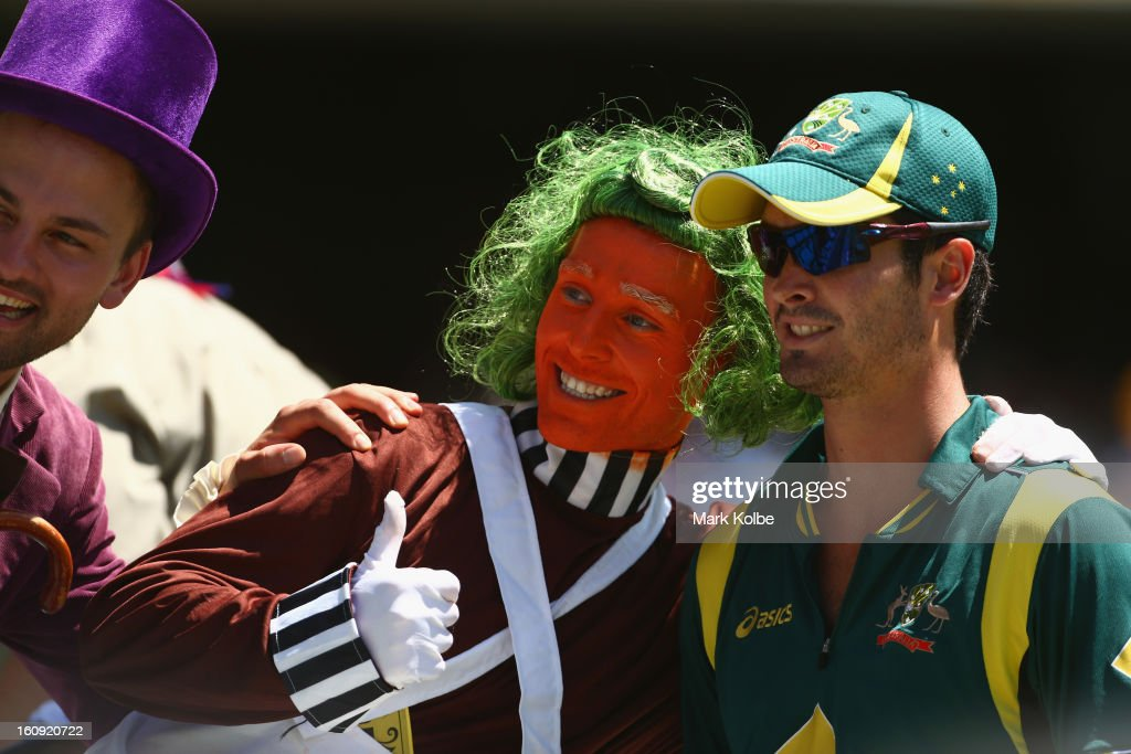 A member of the crowd dressed as an Oompa Loompa has his picture taken with Ben Cutting of Australia during game four of the Commonwealth Bank One Day International Series between Australia and the West Indies at Sydney Cricket Ground on February 8, 2013 in Sydney, Australia.