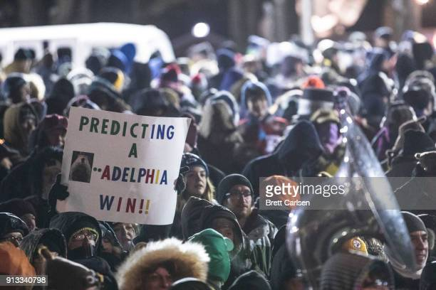 A member of the crowd holds a sign in support of the Philadelphia Eagles during ceremonies for Groundhog Day on February 2 2018 in Punxsutawney...