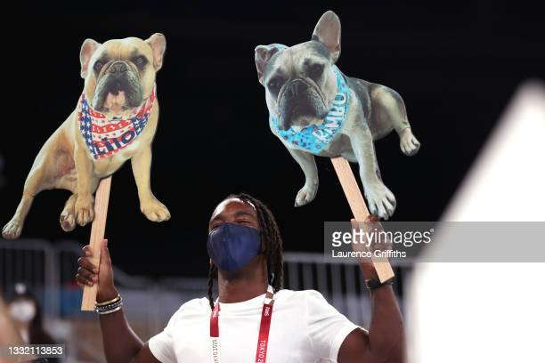 Member of the crowd holds signs with dogs during the Women's Balance Beam Final on day eleven of the Tokyo 2020 Olympic Games at Ariake Gymnastics...