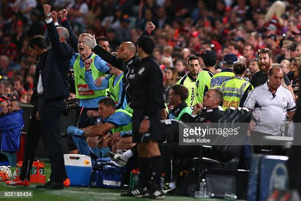 A member of the crowd shouts at the Sydney FC bench as they celebrate victory as police watch on during the round 15 ALeague match between the...