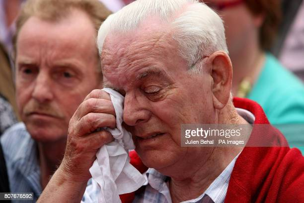A member of the crowd that gather outside the Guildhall in Londonderry to hear the findings of the longawaited Saville Inquiry report into Bloody...