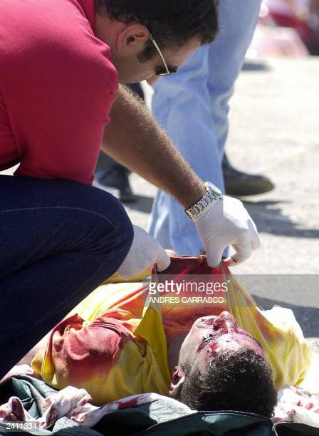 A member of the Cruz Roja pulls the blanket from a bloodcovered face of a dead Moroccan immigrant in the area of Punta Camorro in Tarifa Southern...