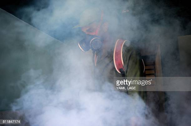 A member of the Cuban army fumigates against the Aedes aegypti mosquito to prevent the spread of zika chikungunya and dengue in Havana on February 23...
