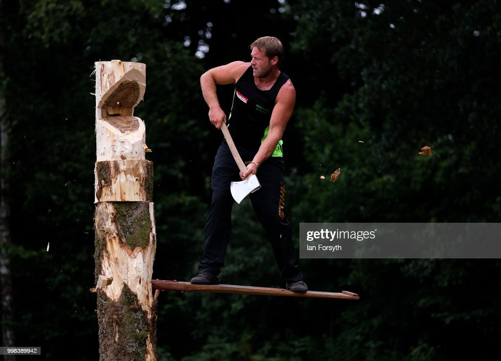 A member of the Cumbrian Axemen demonstrates wood cutting techniques during the final day of the 160th Great Yorkshire Show on July 12, 2018 in Harrogate, England. First held in 1838 the show brings together agricultural displays, livestock events, farming demonstrations, food, dairy and produce stands as well as equestrian events. The popular agricultural show is held over three days and celebrates the farming and agricultural community and their way of life.