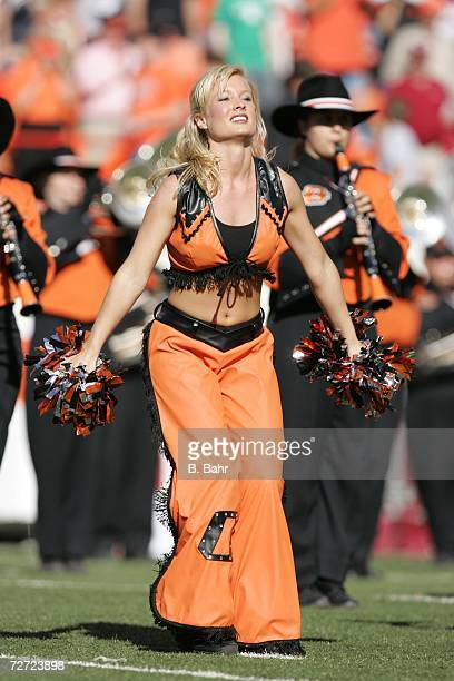 A member of the dance squad cheers before a game between the Oklahoma Sooners and the Oklahoma State Cowboys on November 25 2006 at Boone Pickens...