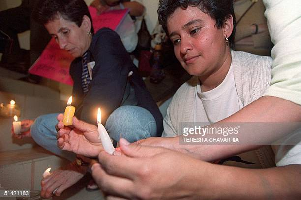 A member of the Delegation of Women lights candles during a vigil that took place 01 November 2000 in one of the rooms in the Legislative Assembly in...