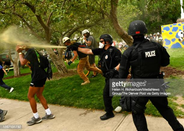 Member of the Denver SWAT team is forced to use pepper spray to calm an angry crowd at Civic Center Park on July 19, 2020 in Denver, Colorado. Pro...