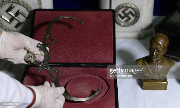 A member of the Department of Protection of the Cultural Heritage of the Federal Police holds an instrument employed to take measurments of the human...