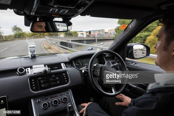 A member of the development team drives a Range Rover Sport Sports Utility Vehicle handsfree during an autonomous driving demonstration by the UK...