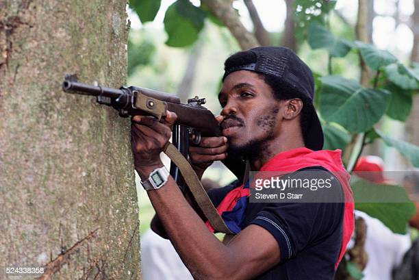 A member of the Dignity Battalion one of General Manuel Noriega's paramilitary forces trains with an assault rifle Noriega rose to power in Panama...