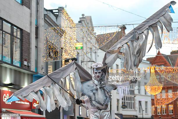 A member of the Dublin Circus Project dressed as angel performs on Dublin's Grafton Street on the New Year Day as a part of New Year's Festival on...