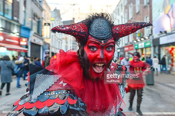 A member of the Dublin Circus Project dressed as devil performs on busy Dublin's Grafton Street on the New Year Day as a part of New Year's Festival...